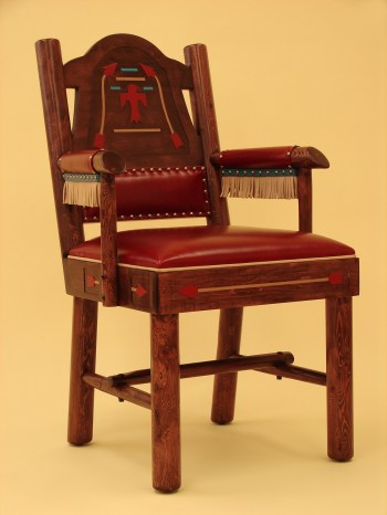 Thunderbird Chair The improved red leather Thuderbird dining chair designed by Thomas Molesworth and improved by Marc Taggart. The artwork is routed by hand, hand painted with gold and turquoise paint, and that arms are wrapped with read leather with gold leather fringe with a turquoise leather band. There have only been eight of these chairs made in the last 20 years.