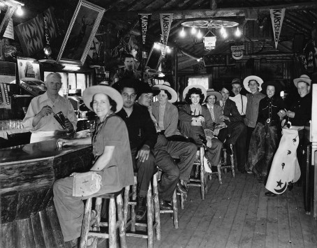 """Karst Bar, early 1940s. Longtime bartender John Fechter serves a group of """"duded up"""" partygoers at this convention in the 1940s. Photo courtesy Arcadia Publishing (Sara Anderson's Karst Collection and Isabelle Durnam Album"""