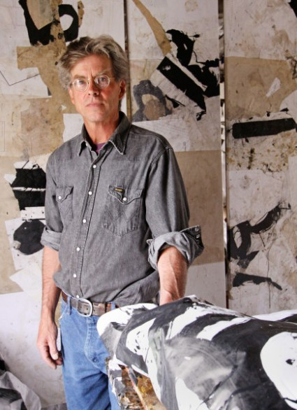 Artist Jerry Iverson standing in front of a work in progress.