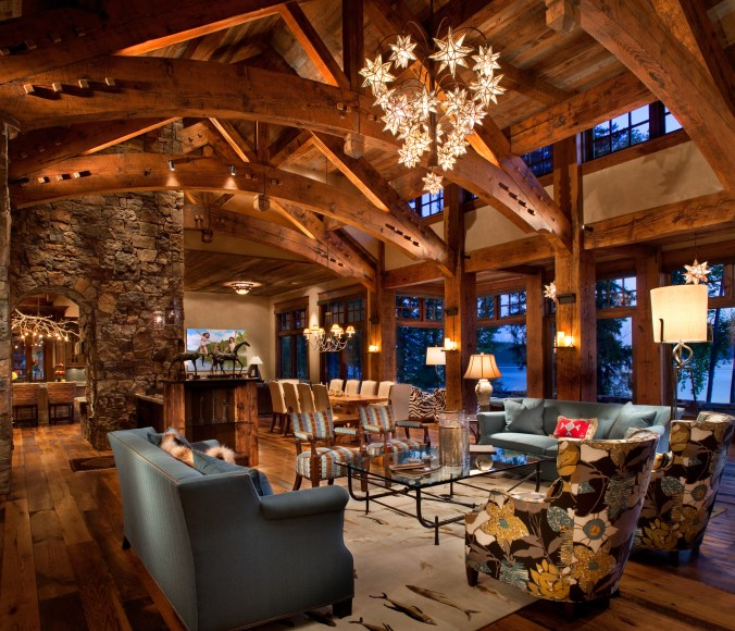 Hunter and Co. interior design responded to the homeowners' desire to blend high style with casual living. Custom lighting, contemporary upholstery and clean lines complement the rustic timbers in the great room.