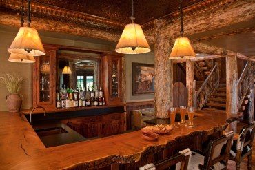 At the owners request, architect Matt Halvorsen designed an authentic western saloon, replete with pressed tin ceilings, mirrored backbar, rustic wood slab bartop and swinging saloon doors.