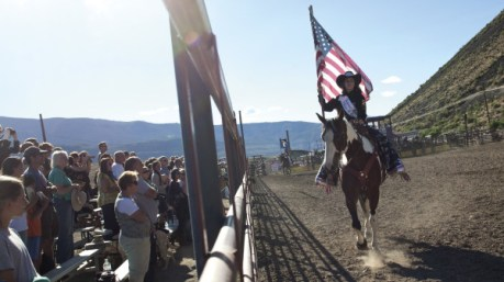 Reigning royalty Cassidy Shay O'Neil, age 17, takes a Flag Run before an enthusiastic audience at the Upper Yellowstone Roundup in Gardiner, Montana. Photo by Janie Osborne
