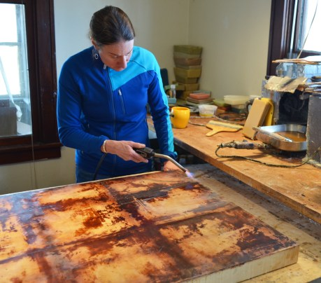 Shawna Moore applies heat to her work in progress at her Whitefish studio.