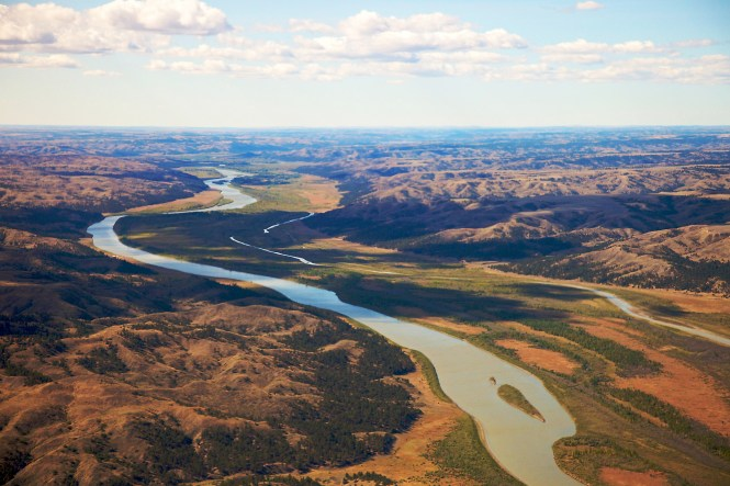 Aerial view of the Missouri River running through the prairie. Photo by Gib Myers