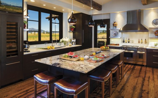 The kitchen makes its own full stylistic statement with modern clean lines. Shannon Lundgren, from Bridger Kitchens, was instrumental in the design of the bath and kitchen cabinetry as well as tile and granite selections, Sue Hodapp said.