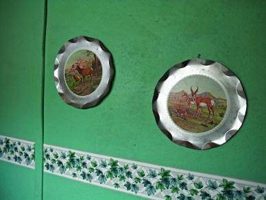 Aluminum wildlife décor hangs in the men's room.
