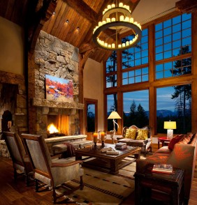 The European, hammer-beam timber trusses and massive chandelier help create a warm and comfortable human scale, while the natural grandeur of the Swan Range rises outside the tall windows.