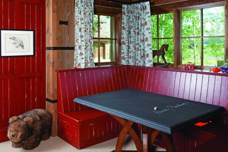 The homeowners have three young sons, but the kids' room has built-in bunk beds, made by the same Ohio craftsmen that did the rest of the home's cabinetry, enough for six. Chambers designed the beds and window nook, including color and finish, to the cabinet makers.