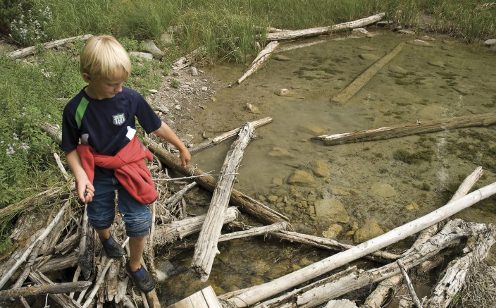 With snake in hand, Max Marty scopes the outlet of Clearwater Lake for a few frogs.