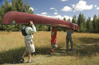 """Max Marty offers to """"help"""" carry the canoe."""