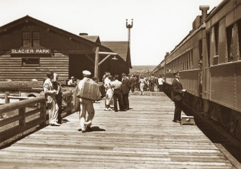 In 1934 passengers prepare to board the westbound Empire Builder at the East Glacier Park station.