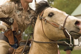An international gathering of sharp-shooting cowgirls at a Cowboy Mounted Shooting event in Darby, Montana.