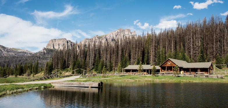 Placid Brooks Lake fronts the historic lodge built in 1922 to house adventurous Easterners on their way to Yellowstone National Park.