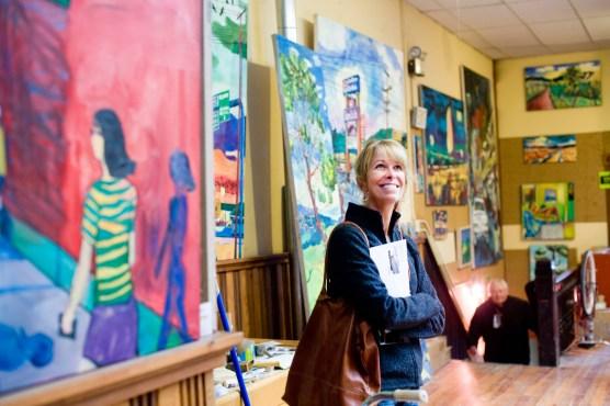 A gallery hopper visits Edd Enders' studio is above The Danforth Gallery on Main Street in Livingston, Montana.
