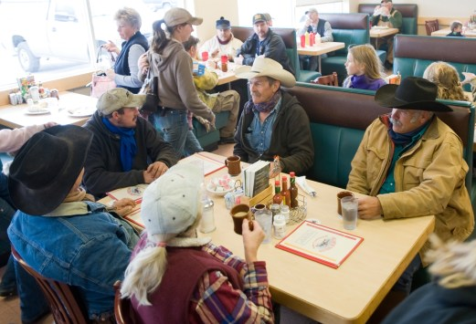 Local ranchers wait out the storm and chat over hot coffee.