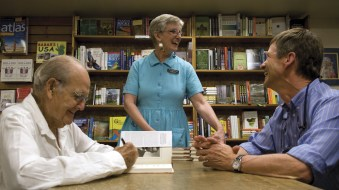 George McGovern and Barbara Theroux share a laugh with a customer while McGovern signed copies of his new book about Abraham Lincoln.