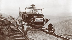 Forest service worker in fire patrol vehicle. The railroad was both a boon and a hindrance to firefighters: Trains enabled them to move through the region quickly, distributing men and supplies, but trains also threw sparks onto the dry landscape, igniting new fires. Photo Library of Congress, Carpentar Collection
