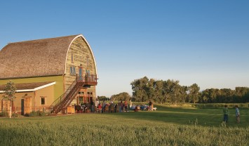 Clyde Park's Double T River Ranch restored an 1880's barn to be a clubhouse for entertaining.