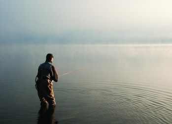 Most people think of bamboo rods as delicate, but many are anything but that. They can be designed to easily fish large, heavy flies, as this angler is doing at dawn on Montana's Hebgen Lake. The rod in use here, is an 8 foot 6-weight Orvis Madison. Photo by John Juracek