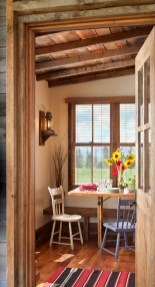 The Paradise Cabin is equipped with a dining nook and follows the simple farm style that pervades on the property.