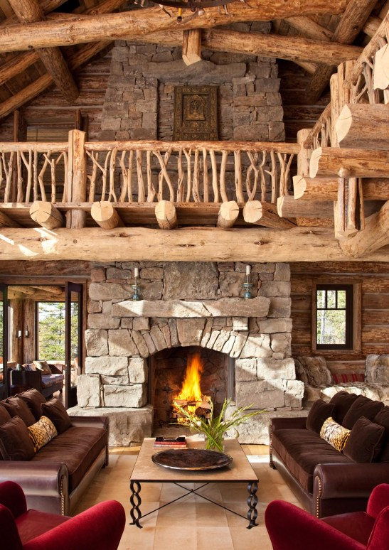 "Using lighter-colored logs from trees that were ""standing dead"" was a request by the owner to keep the interiors lighter than a traditional cabin. The hand-picked juniper banister on the mezzanine showcases the talents of the builder, Lohss Construction."