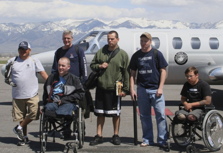 The Warriors arrive at Gallatin Field on a Marine Corps Jet. From left to right are: Alroy Billiman US Army, Joshua Cope US Army, Richard Vattuone US Army National Guard (Calif), Elmer Ugarte USMC, Nathan Handville USMC, Tim Jeffers USMC Photo by Eric Has