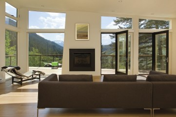 The soaring ceilings in the great room help make the space feel big; the lack of right angles – every corner is three-degrees off – keeps the design interesting, even when it has to compete with a wall of windows looking out at the Snake River.