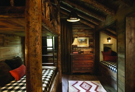 The bunkroom and bedrooms echo log cabin roots while incorporating luxurious textiles for the bedding.