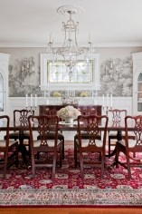 In the dining room handpainted antique wallpaper from France and an original stained glass window add elegant detail to the home.