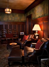 "Original handpainted English wallpaper from the 1920s balances the masculine tone of the ""cigar room."" Langlas & Associates were able to restore the original oak flooring and Craftsman light fixtures designed by Fred Willson."