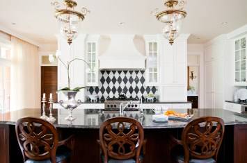 The graphic quality of a Harlequin-pattern tile backsplash creates a focal point in the clean-lined contemporary kitchen, Montana Tile and Stone was a source of inspiration as Indreland selected tile, granite and marble accents throughout the house.