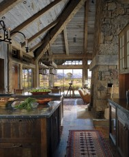 In the open living space, custom features, such as the patinated metal finish on the kitchen island or the one of a kind chandelier over the dining room table, are details that cultivate a uniquely personal feeling within the home.