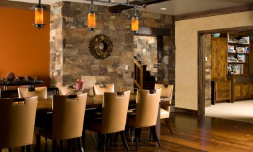 The dining space boasts a reclaimed chestnut table made by a local builder, and lights designed by artists Will Wilkins.