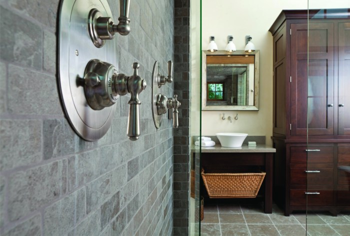 """The master bath not only has a steam shower, but also a bronze soaking tub. """"It's one of my favorite bathrooms,"""" interior designer Chambers says."""
