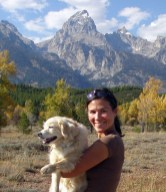 Wildlife and landscape artist Mimi Matsuda poses with her dog, Cassidy, in Grand Teton National Park, Wyoming. Photo by Erika Matsuda