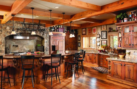 Furniture-style cabinetry was crafted by Bear Paw Custom Wood Works using antique barn wood and custom hand-forged hardware by Trapper Peak Forge.