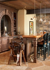Local stone floors mixed with exposed I-beams creates a rustic, yet clean finish in the downstairs.