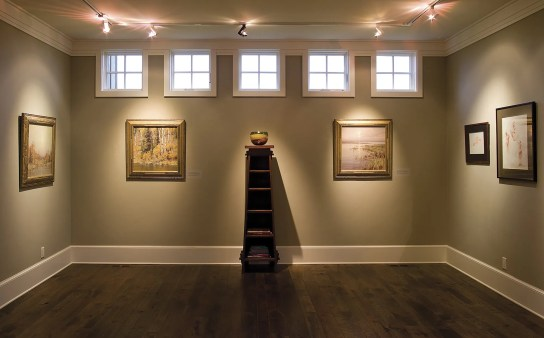Many of the finished pieces hanging in the gallery adjoining his studio are there simply as reference. Framed works and progress also adorn the walls.