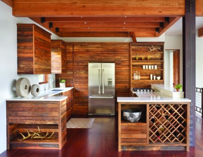 Cabinets made from recycled Wyoming snow fencing are offset by smooth countertops, imparting an organic, contemporary aesthetic in the kitchen.