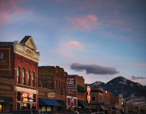 The clouds churn over the top of Main Street Livingston with a Mint Bar tucked neatly in the middle — just where it should be.