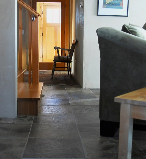 Refuge offers a variety of affordable natural materials for flooring and countertops, including this Madison Slate in the home of Carbon Neutral Builders owner Adrien Tanguay. Home design by Zimtor Architecture.