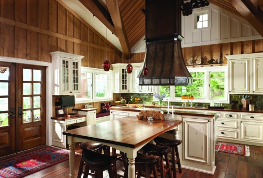 Mortise-and-tenon timber framing in the gable-roofed kitchen creates an appearance of a later addition to the stacked logs in the main house.