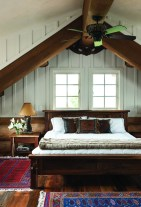 Continuity of design is carried throughout the home, including the private master bedroom with its vaulted ceiling.