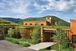 Native grasses incorporated into the sod roofs of a newly completed Aman Villa melds the architecture to the landscape.
