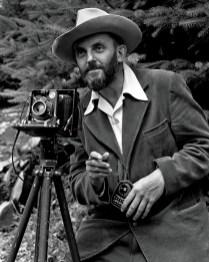Ansel Adams in 1947, light meter in hand.