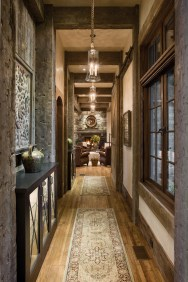 Project architect Darin Hoekema utilized a breezeway to the private bedrooms as a gallery to display the owners extensive collection of Native American artifacts and arrowheads.