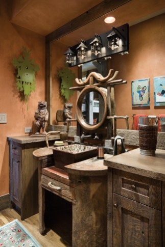 Incorporating antiques and rustic details for this home was half the fun for interior designer Janet Baker and her long-time client. This powder room encompasses all the playful elements of design for the kids' bunkroom.