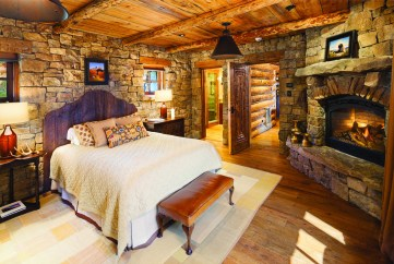 There are seven indoor and outdoor fireplaces in the home, one of which is in the master bedroom. The use of reclaimed and natural materials is fluid throughout the home.