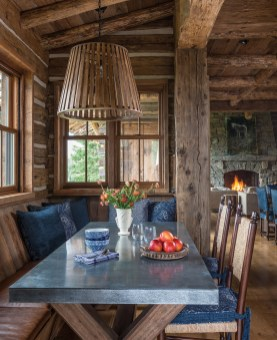 A favorite place for family meals and après ski tapas, the cozy east-facing breakfast nook is furnished with a custom tin-topped table, handcrafted light fixture and whimsical Ralph Lauren upholstery.