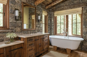 Laura Fedro Interiors specified the Victoria and Albert tub for its depth and dual ends. It's the perfect place to soak after a day on the slopes. Custom cabinets built by Crown Creations and a warm, rich mohair runner finish the space.